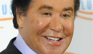 ** FILE ** In this May 6, 2010, file photo, Wayne Newton arrives at the 10th Annual Lupus LA Orange Ball in Beverly Hills, Calif. (AP Photo/Chris Pizzello, file)