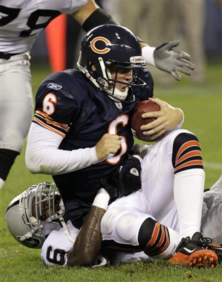 Chicago Bears quarterback Jay Cutler (6) is sacked Oakland Raiders linebacker Kamerion Wimbley, bottom, in the first half of a preseason NFL football game in Chicago, Saturday, Aug. 21, 2010. (AP Photo/Charles Rex Arbogast)