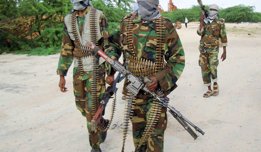 Islamist al-Shabab fighters conduct a military exercise in northern Mogadishu, Somalia. With no functioning government since 1991, militants with guns have been filling the social-justice void in Somalia with violence. (Associated Press)