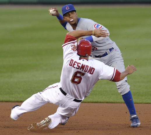 ASSOCIATED PRESS Washington Nationals Ian Desmond, (6) is out at second base as Chicago Cubs  shortstop Starlin Castro throws the ball to complete the double play during the first inning of their baseball game at Nationals Park in Washington, Wednesday, Aug. 25, 2010.