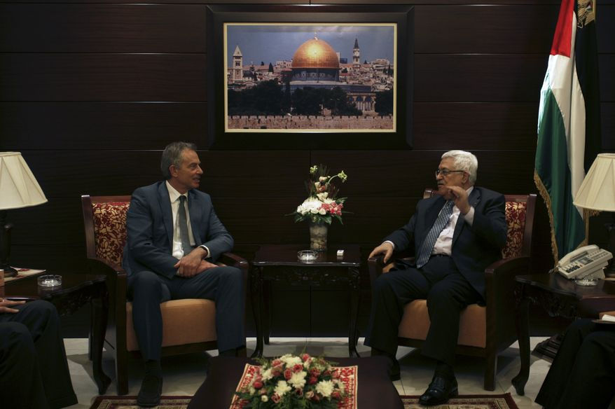 Former British Prime Minister Tony Blair (left), envoy of the Middle East Quartet, which comprises the United Nations, European Union, United States and Russia, meets with Palestinian President Mahmoud Abbas in the West Bank city of Ramallah on Wednesday, Aug. 25, 2010. Mr. Blair on Tuesday called on Israelis and Palestinians to bring serious proposals to a new round of peace talks set to start Sept. 2. (AP Photo/Majdi Mohammed)