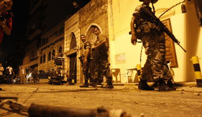Lebanese soldiers patrol in front of a mosque of the Sunni Muslim Association of Islamic Charitable Project, known as the Al-Ahbash group, after clashes erupted between group members and supporters of the Shi'ite Hezbollah group in the Bourj Abu Haidar area near Beirut's downtown on Lebanon, Tuesday, Aug. 24, 2010. (AP Photo/Hussein Malla)