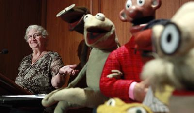 Jane Henson donates some of Jim Henson's early puppets, including the original Kermit the Frog, to the Smithsonian Institution during a ceremony at the National Museum of American History in Washington on Wednesday, Aug. 25, 2010. (AP Photo/Jacquelyn Martin)