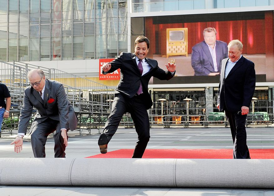 ASSOCIATED PRESS Jimmy Fallon (center), host of the 62nd Primetime Emmy Awards, is joined by John Shaffner (left), Academy of Television Arts & Sciences chairman and chief executive officer; and the show's executive producer, Don Mischer, at the Nokia Theater in Los Angeles on Wednesday.