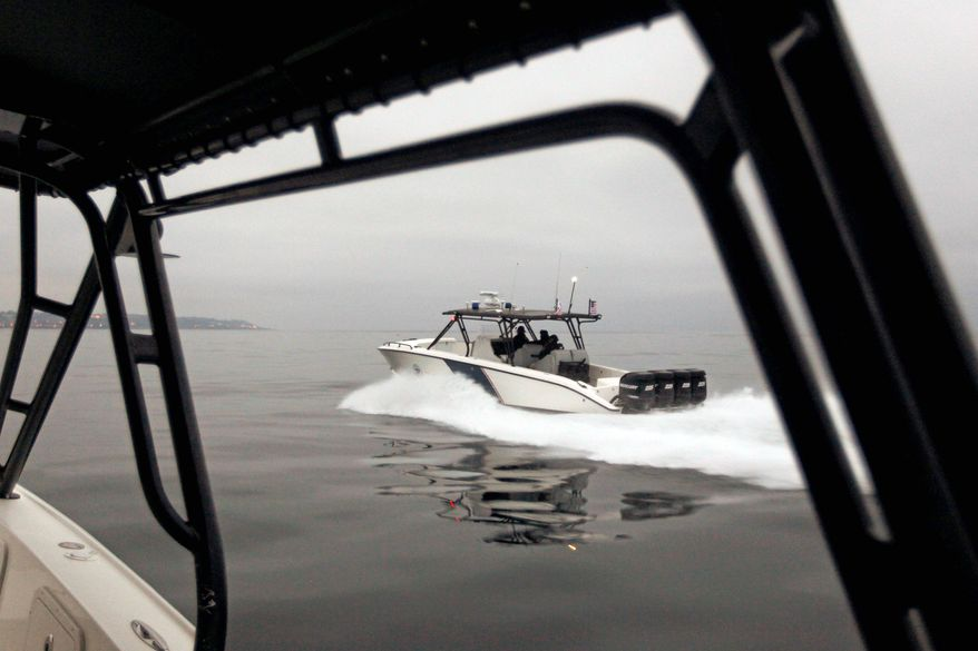 U.S. Customs and Border Protection agents patrol on a speedboat near the California-Mexico border off the coast of San Diego in late July. The California-Mexico coastline has become a new frontier for illegal immigrants entering the United States. (Associated Press)