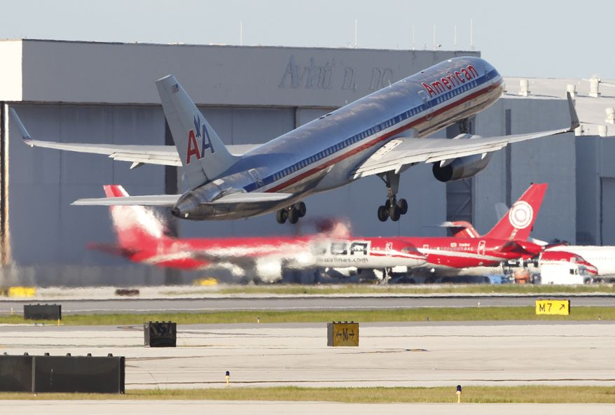 An American Airlines Boeing 757 jet takes off from Miami International Airport in Miami on Wednesday, Aug. 18, 2010. Federal officials have hit the airline with a record penalty of $24.2 million over maintenance lapses that caused thousands of canceled flights in 2008. (AP Photo/Wilfredo Lee)