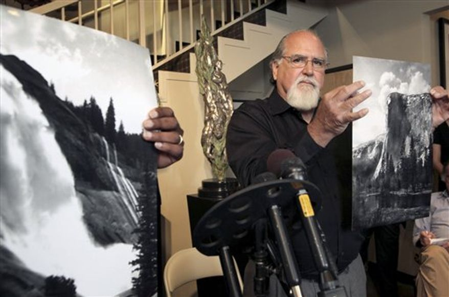 FILE - In this Jully 27, 2010 file photo, Rick Norsigian holds up a photograph made from a glass negative shot by the late photographer Ansel Adams during a news conference in Beverly Hills, Calif. A group representing Ansel Adams sued Norsigian Monday, Aug. 23, 2010, for selling prints and posters under the name of the famed nature photographer, offering up the latest salvo in a dispute over glass negatives bought at a garage sale and purported to be Adams' lost work. (AP Photo/Nick Ut, file)