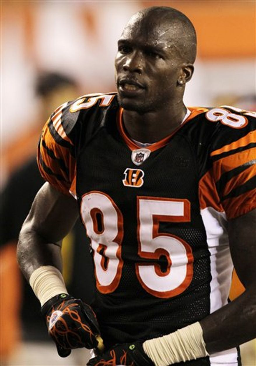 FILE - In this Aug. 20, 2010, file photo, Cincinnati Bengals wide receiver Chad Ochocinco looks on during the first half of an NFL preseason football game against the Philadelphia Eagles in Cincinnati.  Ochocinco was fined $25,000 by the NFL on Tuesday, Aug. 24, 2010, for the timing of his tweets.  The league said Ochocinco's messages appeared on his Twitter page during a prohibited time during the Bengals-Philadelphia Eagles preseason game on Friday. It said the Bengal player violated policies on electronic device possession and posting of social media messages. (AP Photo/Ed Reinke, File)