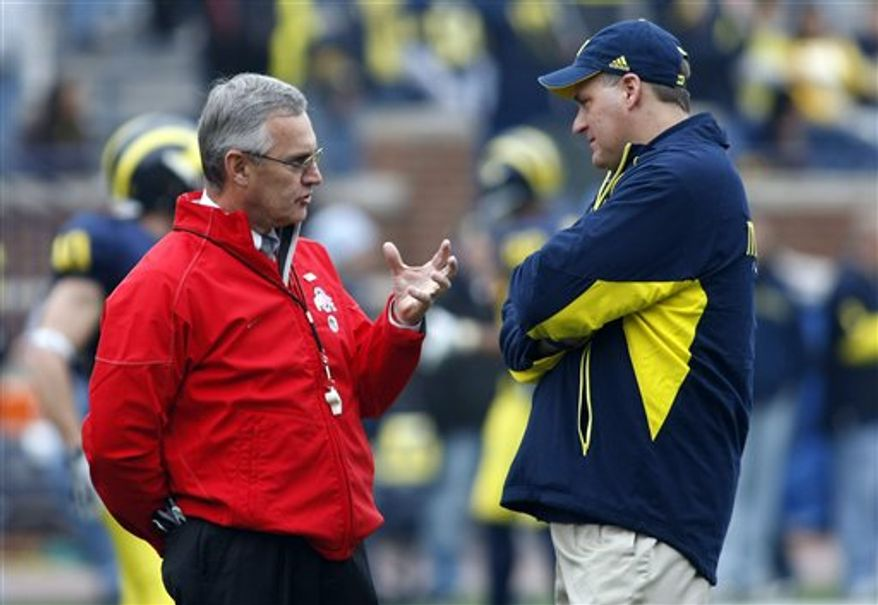 FILE - In this Nov. 21, 2009, file photo, Ohio State head coach Jim Tressel walks the sidelines against Michigan during the fourth quarter of an NCAA football game in Ann Arbor, Mich., Saturday, Nov. 21, 2009.  Since 1943, fans have always known where to find the annual showdown between Michigan and Ohio State: Right at the end of the schedule.   With the Big Ten expanding to 12 teams in 2011 and also going to divisional play and a conference championship game, that sacred spot closing out the regular season is no longer a certainty. (AP Photo/Paul Sancya, File)