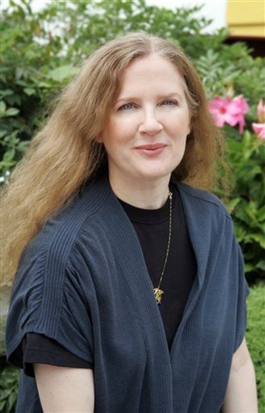 In this publicity image released by Scholastic, author Suzanne Collins is shown in New York on Aug. 12, 2009. (AP Photo/Scholastic, Todd Plitt)