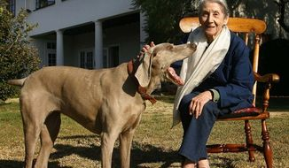 In this photo taken March 19, 2007 Nobel laureate for literature Nadine Gordimer,  with her dog at her home in Johannesburg. Gordimer is leading South African writers in speaking out against proposed laws she fears will muzzle freedom of speech in her homeland (AP Photo/Jerome Delay, File))
