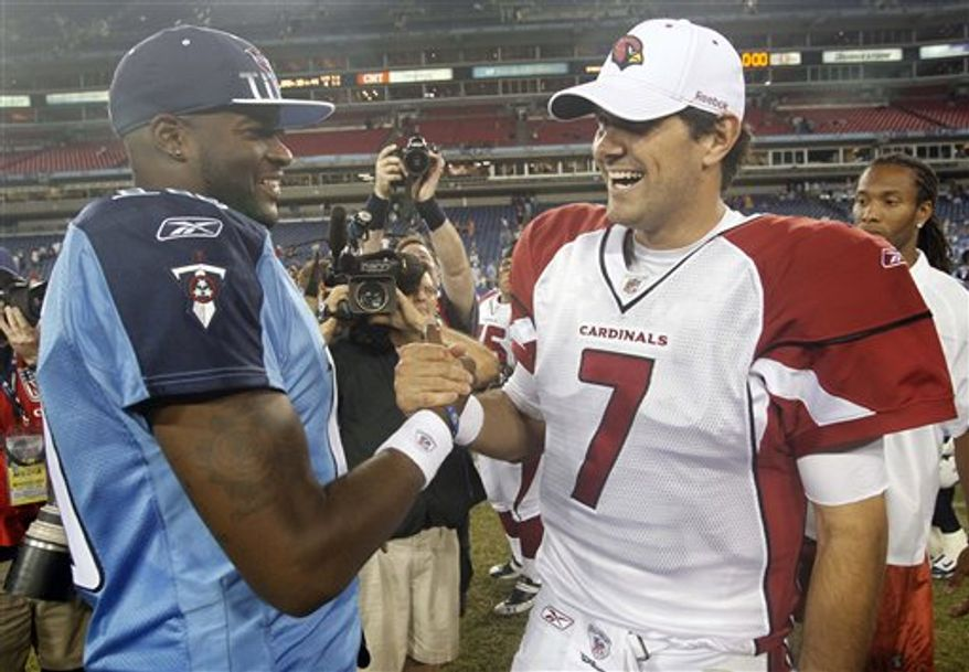 Tennessee Titans quarterback Vince Young, left, and Arizona Cardinals quarterback Matt Leinart (7) meet on the field after the Titans won 24-10 in a preseason NFL football game on Monday, Aug. 23, 2010, in Nashville, Tenn. (AP Photo/Wade Payne)