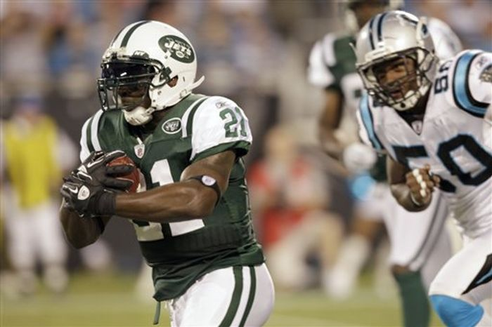 New York Jets running back LaDainian Tomlinson (21) runs past Carolina Panthers linebacker James Anderson (50) in the first quarter of a preseason NFL football game in Charlotte, N.C., Saturday, Aug. 21, 2010. (AP Photo/Chuck Burton)