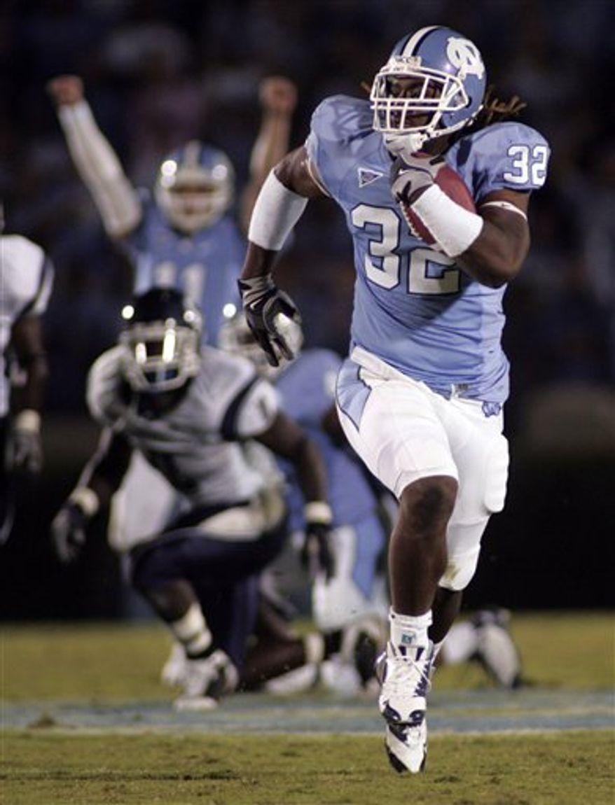FILE - In this Oct. 4, 2008, file photo, North Carolina's Ryan Houston (32) carries with the ball during a NCAA college football football game against Connecticut in Chapel Hill, N.C., Saturday, Oct. 4, 2008.  (AP Photo/Jim R. Bounds)