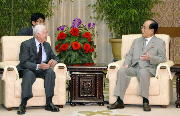 ** FILE ** Former President Jimmy Carter (left) meets with North Korea's No. 2 official, Kim Yong Nam, at Mansudae Assembly Hall in Pyongyang, North Korea, on Wednesday, Aug. 25, 2010. (AP Photo/Kyodo News)