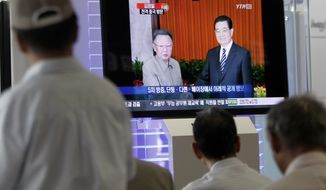 South Koreans watch a TV broadcasting file footage of North Korean leader Kim Jong-il, left, meeting with Chinese President Hu Jintao, at a railway station in Seoul, South Korea, Thursday, Aug. 26, 2010. News reports say Mr. Kim may have traveled to China in what would be his second visit to the country this year.(AP Photo/Ahn Young-joon)