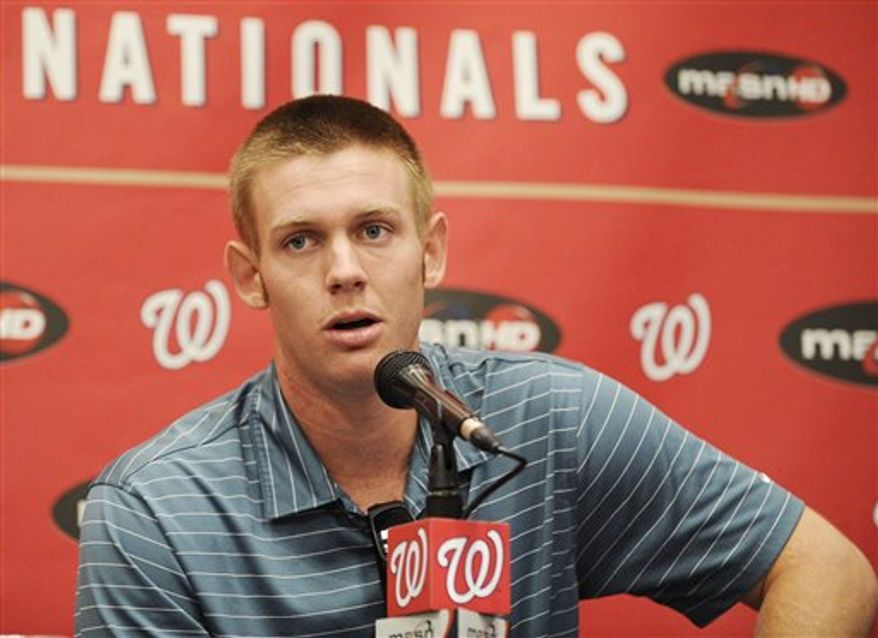 Washington Nationals pitcher Stephen Strasburg talks to the media about his injury during a press conference before a baseball game against the St. Louis Cardinals, Friday, Aug. 27, 2010, in Washington. Strasburg has a torn elbow ligament and will likely have Tommy John surgery, bringing the pitcher's promising rookie season to an abrupt end. (AP Photo/Nick Wass)