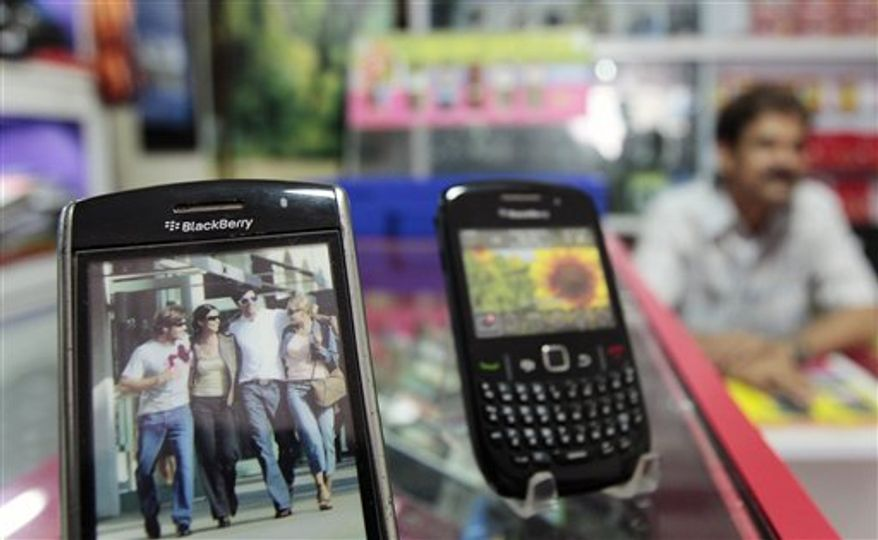 FILE - In this Aug. 5, 2010 file photo, Blackberry mobile phones are displayed at a shop in Mumbai, India. Research In Motion Ltd., the maker of the BlackBerry, said Thursday, Aug. 26, it is seeking to involve other technology companies in its talks with the Indian government, which wants access to the e-mails of BlackBerry users. (AP Photo/Rajanish Kakade, file)