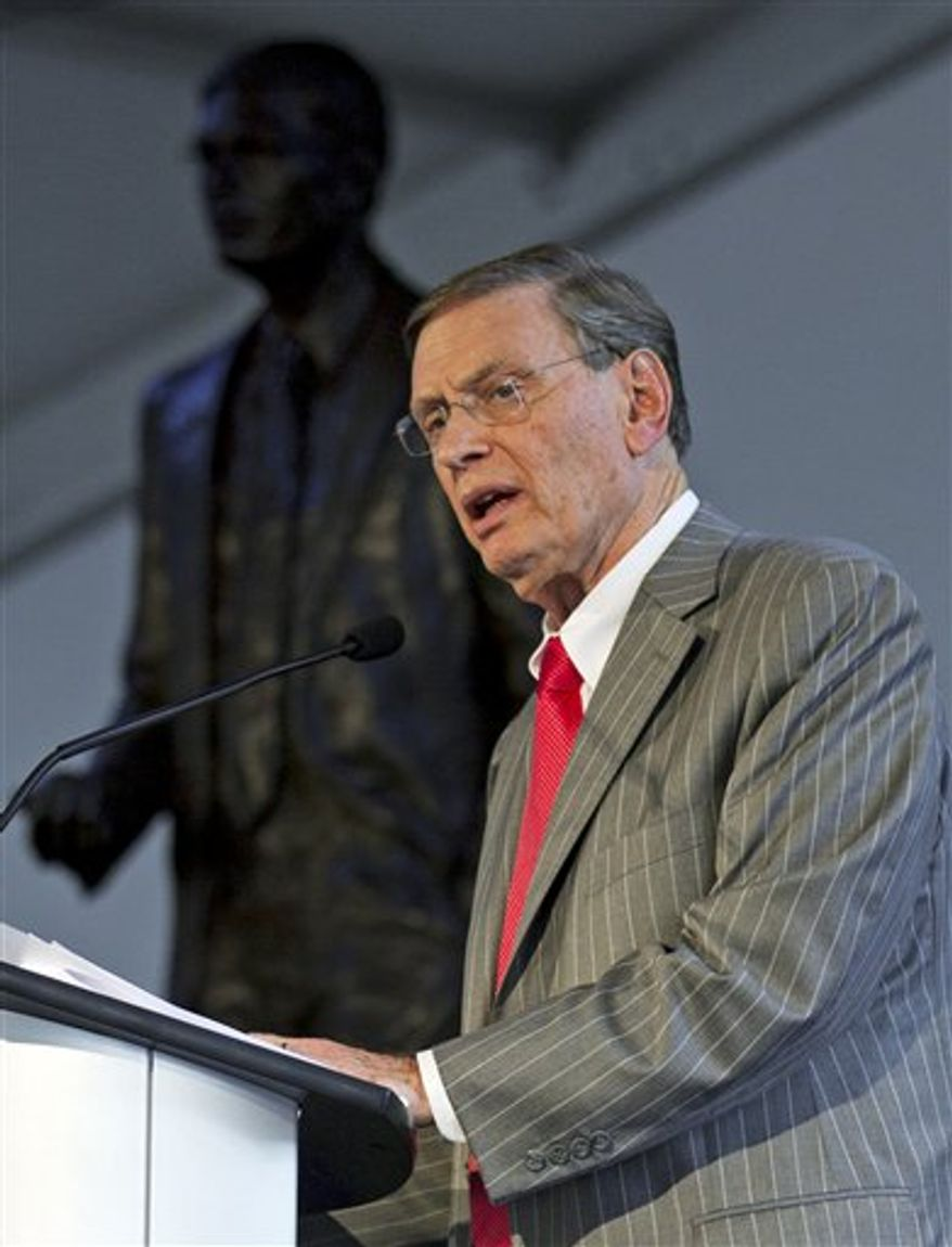 Major League Baseball commissioner Bud Selig hugs former Milwaukee Brewers' Hank Aaron at a ceremony to unveil a statue of Selig outside Miller Park Tuesday, Aug. 24, 2010, in Milwaukee. Selig is the former owner of the Brewers. (AP Photo/Morry Gash)