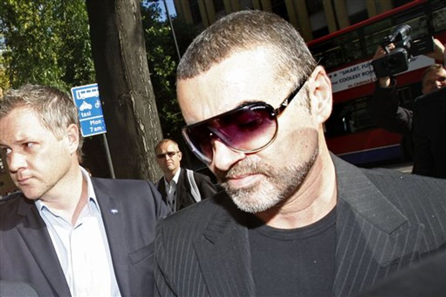 British singer George Michael arrives for sentencing at Highbury magistrates court in London, Tuesday, Sept. 14, 2010. George Michael is facing a fine or jail time after he admitted driving while under the influence of drugs. The singer pleaded guilty last month to driving under the influence and possession of cannabis following an incident on July 4 when his Range Rover crashed into a photo shop in north London.  (AP Photo/Kirsty Wigglesworth)