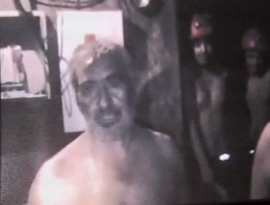 An image made from a video released by Television Nacional de Chile via the Chilean government Thursday Aug. 26, 2010, shows the trapped miners in their underground chamber. (AP Photo/Television Nacional de Chile)