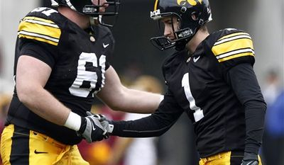 FILE - In this Nov. 21, 2009, file photo, Iowa's Daniel Murray, right, celebrates with teammate Travis Meade after making a 45-yard field goal during the second half of an NCAA college football game against Minnesota in Iowa City, Iowa. Iowa has become known for nailbiting finishes, which often leaves the Hawkeyes in need of a kicker they can trust in the clutch. Senior Daniel Murray, whose game-winning field goal against Penn State two years ago helped launch the program's resurgence, entered fall camp in a dead heat with sophomore Trent Mossbrucker for the job. (AP Photo/Charlie Neibergall)