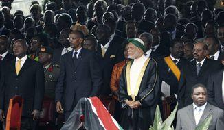 Ugandan President Yoweri Museveni, left, Rwandan President Paul Kagame, second from left, Comoros President Ahmed Abdallah Mohamed Sambi, third from right, and Sudan President Omar Bashir, second from right, attend the signing into law of the new Kenyan constitution, at Uhuru Park in Nairobi, Kenya, Friday, Aug. 27, 2010. (AP Photo/Khalil Senosi)