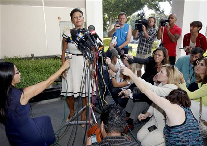 This image taken from video provided by Entertainment Tonight shows Lindsay Lohan as she enters Kamofie and Co. in Venice, Calif. on Jan. 21, 2011. (AP Photo/Entertainment Tonight) THE BROADCAST BUG MUST REMAIN ONSCREEN AND UNOBSCURED FOR THE DURATION THE PHOTO IS USED AND CANNOT BE CROPPED OUT. NO SALES.