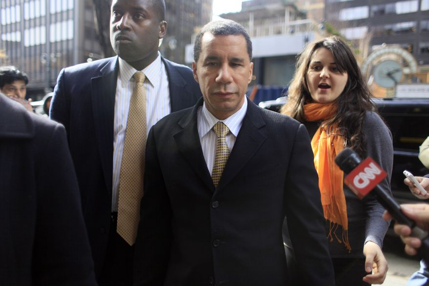 New York Gov. David Paterson, center, arrives at his New York City office, in this March 5, 2010, file photo. In a report Thursday, Aug. 26, 2010, former state Chief Judge Judith Kaye noted four of five of Mr. Paterson's tickets to the World Series opening game between the Yankees and the Philadelphia Phillies were paid for shortly afterward, following a press inquiry from the New York Post newspaper. (AP Photo/Mary Altaffer, File)