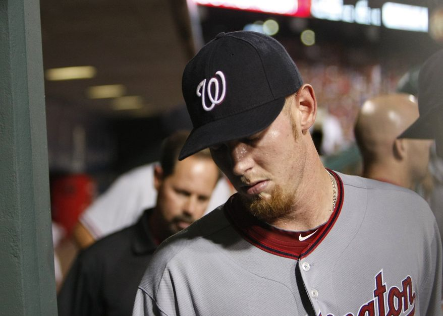 FILE - In this Aug. 21, 2010 file photo, Washington Nationals pitcher Stephen Strasburg heads to the clubhouse through the dugout after leaving the fifth inning of a baseball game against the Philadelphia Phillies in Philadelphia. Strasburg left with an apparent injury to his right wrist. (AP Photo/The Philadelphia Inquirer, Ron Cortes, File)