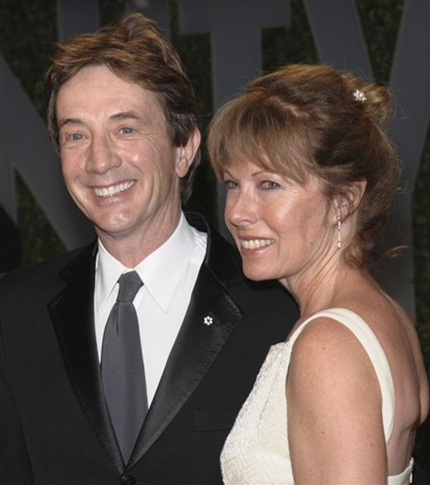 FILE - In this Feb. 22, 2009 file photo, actor Martin Short and his wife Nancy Dolman arrive at the Vanity Fair Oscar party in West Hollywood, Calif. Short's manager on Monday, Aug. 23, 2010 said that Dolman, Short's wife of 30 years, has died. She was 58. (AP Photo/Evan Agostini, File)