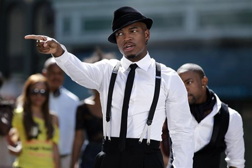 """FILE - In this July 21, 2010 file photo, musician Ne-Yo dances while filming a music video for his upcoming single """"One in a Million"""" on the Universal Studios lot in Los Angeles.  (AP Photo/Matt Sayles, file)"""