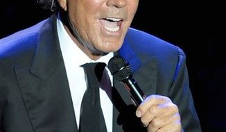 FILE - In this Aug. 14, 2008 file photo, Spanish singer Julio Iglesias performs during a concert at Cap Roig festival in Calella de Palafrugell, Spain. (AP Photo/Manu Fernandez, file)