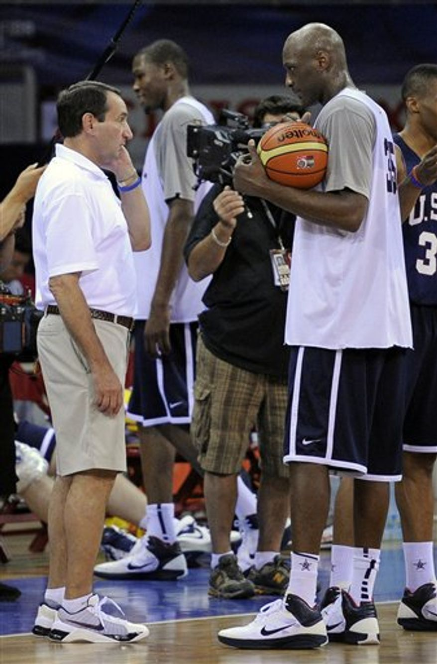 USA's Chauncey Billups, right, and head coach Mike Krzyzewski applaud during the final of the World Basketball Championship between Turkey and the USA, Sunday, Sept. 12, 2010, in Istanbul.  (AP Photo/Mark J. Terrill)