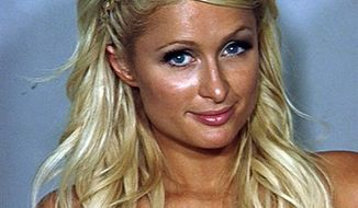 In this photo released Saturday, Aug. 28, 2010 by the Las Vegas Metropolitan Police Department, Paris Hilton poses for a police booking photo in Las Vegas. Paris Hilton was arrested late Friday after a police motorcycle officer smelled marijuana smoke wafting from a black Cadillac Escalade driven by her boyfriend on the Las Vegas Strip, then found cocaine in her purse, authorities said. (AP Photo/Las Vegas Metropolitan Police Department)