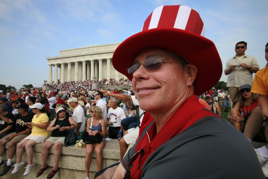 "James Johnson, of Delray Beach, Fla., right, attends the ""Restoring Honor"" rally, organized by Glenn Beck, at the Lincoln Memorial in Washington, on Saturday, Aug. 28, 2010. (AP Photo/Jacquelyn Martin)"