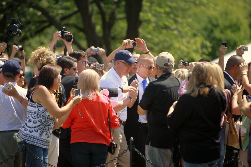 Supporters rush toward Glenn Beck, center, as he visits the site of the Restoring Honor rally by the Lincoln Memorial in Washington, on Friday, Aug. 27, 2010. The rally will take place on Saturday. (AP Photo/Jacquelyn Martin)