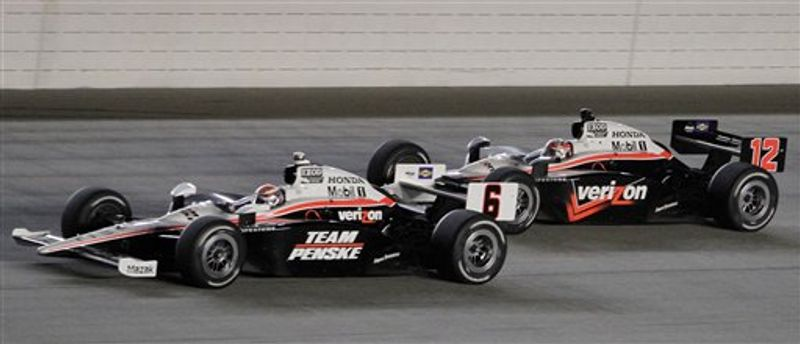 Ryan Briscoe, left, of Australia, drives his car past compatriot Will Power during the IndyCar Series auto race at Chicagoland Speedway in Joliet, Ill., Saturday, Aug. 28, 2010. (AP Photo/Nam Y. Huh)