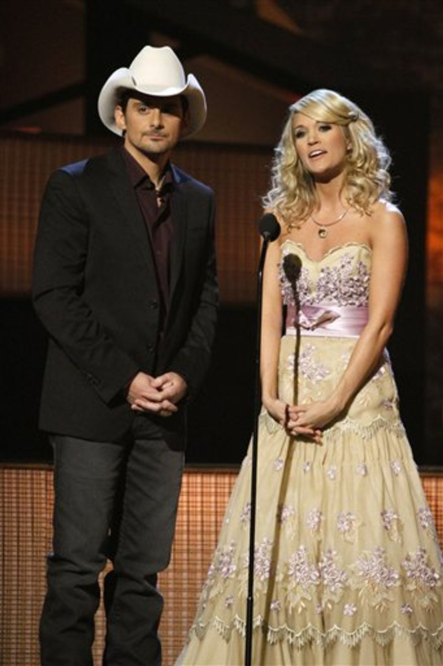 FILE - In this Nov. 11, 2009 file photo, Brad Paisley and Carrie Underwood host the 43rd Annual Country Music Awards in Nashville, Tenn. (AP Photo/Mark Humphrey, file)