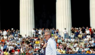 "Radio and TV talk-show host Glenn Beck speaks at his ""Restoring Honor"" rally at the Lincoln Memorial in Washington on Saturday. ""One man can change the world,"" Mr. Beck told the gathering on the Mall. (Associated Press)"