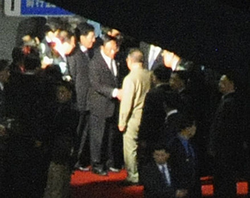 A man believed to be North Korean leader Kim Jong-il (center, facing away from camera, is greeted at Changchun rail station in Changchun, China, on Saturday, Aug. 28, 2010. Mr. Kim reportedly has met top Chinese leaders in an apparent bid for Beijing's diplomatic and financial support for a succession plan involving his third and youngest son, who is said to be traveling with him. (AP Photo/Kyodo News Agency)