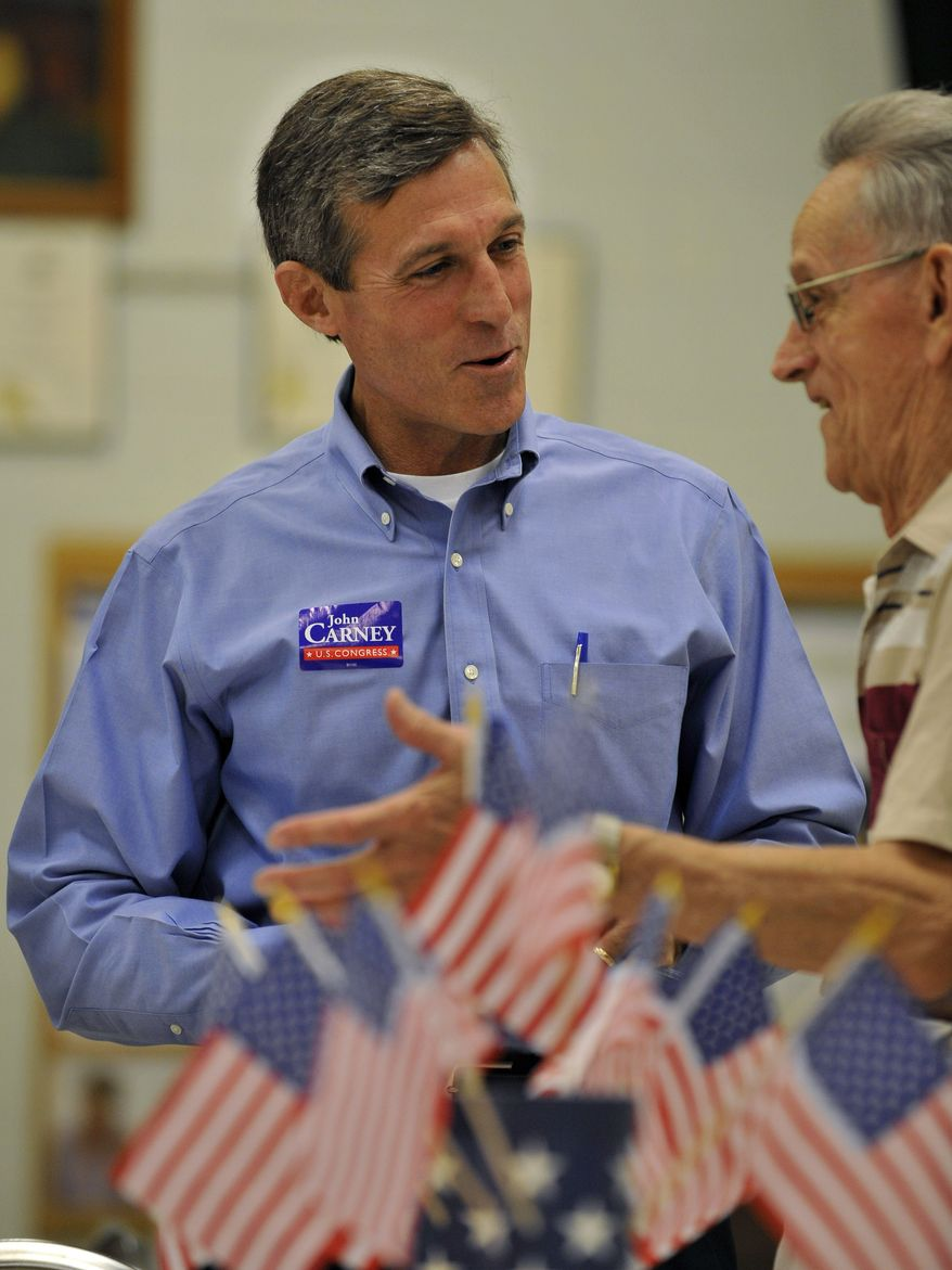 John Carney, a Democratic candidate for Delaware's single U.S. House seat, talks with Lou Best at a senior center in Wilmington, Del. (AP Photo/Gail Burton)