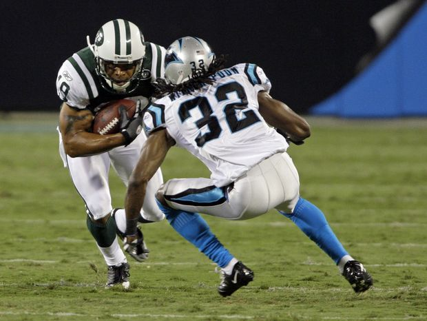 ASSOCIATED PRESS New York Jets' Laveranues Coles (19) runs after a catch as Carolina Panthers' Brian Witherspoon (32) defends in the third quarter of the Jets' 9-3 win in a preseason NFL football game in Charlotte, N.C., Saturday, Aug. 21, 2010.