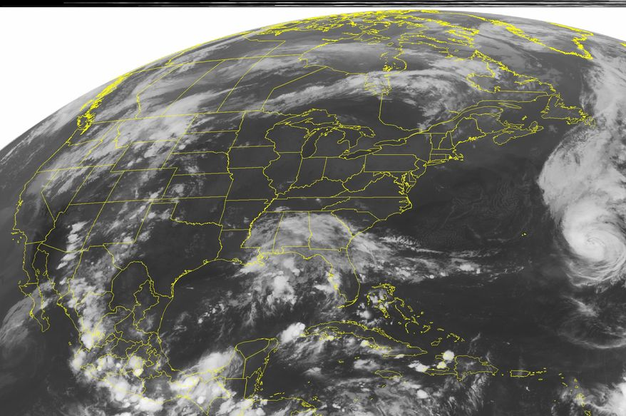 A NOAA satellite image taken on Sunday, Aug. 29, 2010, at 3 a.m. EDT shows clouds associated with Hurricane Danielle on the right side of the image as the storm moves northeastward away from any major land masses. (AP Photo/Weather Underground)