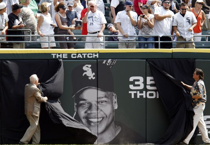 ASSOCIATED PRESS Former Chicago White Sox player Frank Thomas' face is unveiled on the outfield wall before a baseball game between the New York Yankees and the White Sox in Chicago, Sunday, Aug. 29, 2010. Thomas is the 10th White Sox player whose number has been retired and whose face appears on the outfield wall.