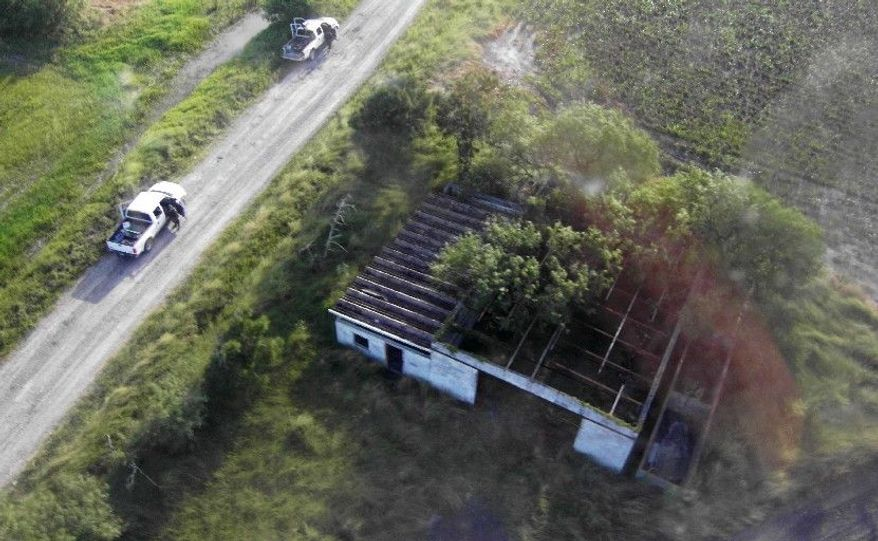 The abandoned warehouse in San Fernando in eastern Mexico where the 58 male and 14 female massacre victims were found is seen. (Associated Press)