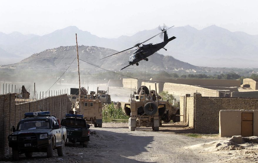 A U.S. Army helicopter takes off carrying soldiers wounded in a roadside bombing in Kandahar, Afghanistan, on Monday, Aug. 30, 2010. Eyewitnesses said a U.S. military armored Humvee caught fire after having been struck by the bomb in a residential area of Kandahar, Afghanistan's second-largest city, while returning in a convoy from an unknown mission. (AP Photo/Allauddin Khan)
