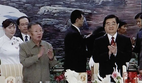 In this image made on Monday, Aug. 30, 2010, from China Central Television footage, North Korea's Kim Jong-il (third from left) applauds with Chinese President Hu Jintao (right) during a banquet in Changchun, in northeast China's Jilin province, on Friday, Aug. 27, 2010. (AP Photo/CCTV via APTN)