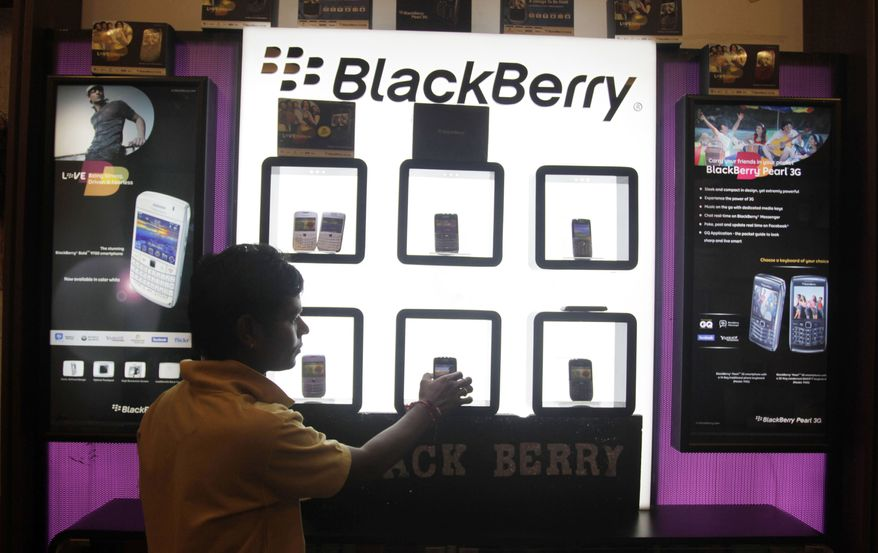 A shopkeeper displays BlackBerry mobile phones in his store in Ahmadabad, India, on Friday, Aug. 27, 2010.  (AP Photo/Ajit Solanki)