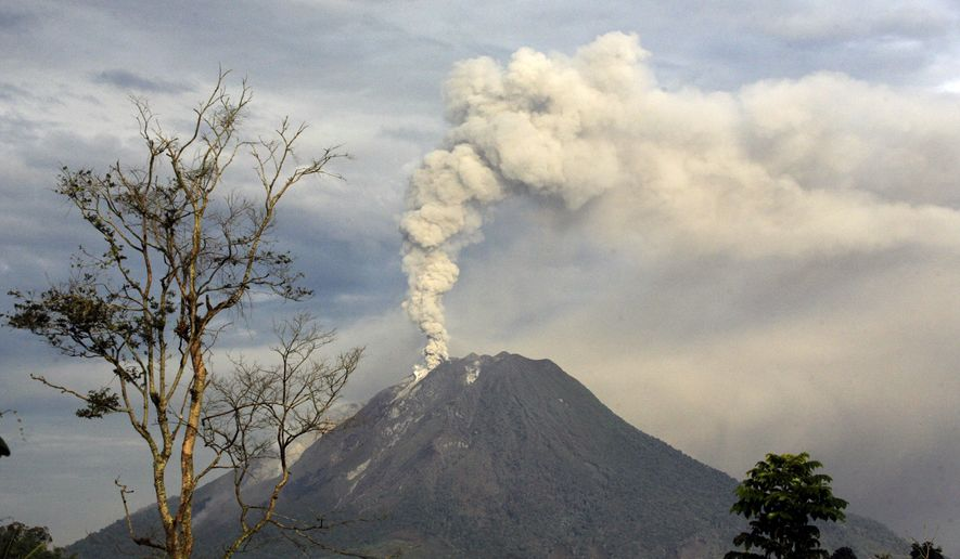 Mount Sinabung, near Karo on North Sumatra in Indonesia, erupted for the second day in a row Monday, spewing out towering clouds of ash and forcing the evacuation of more than 30,000 people. (AP Photo/Binsar Bakkara)